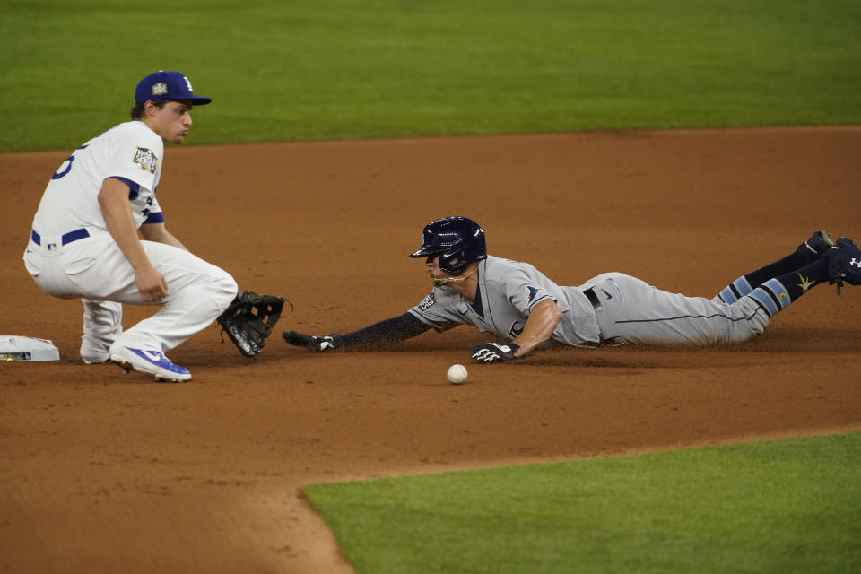 Tampa Bay Rays' Willy Adames is tagged out at second stealing by Los Angeles Dodgers shortstop Corey Seager during the second inning in Game 2 of the baseball World Series Wednesday, Oct. 21, 2020, in Arlington, Texas. (AP Photo/Tony Gutierrez)