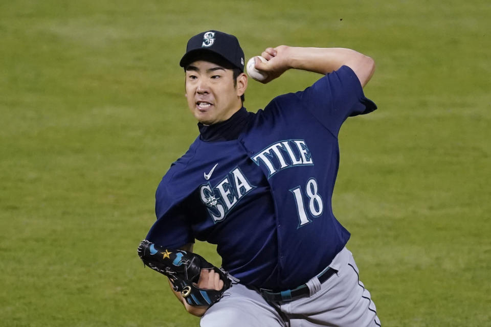 Seattle Mariners starting pitcher Yusei Kikuchi (18) throws during the fifth inning of a baseball game against the Los Angeles Angels Saturday, June 5, 2021, in Anaheim, Calif. (AP Photo/Ashley Landis)
