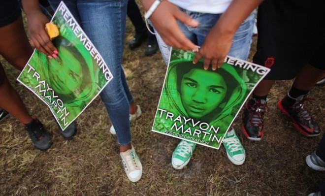 "People stand together on Feb. 9 in honor of Trayvon Martin during a ""March for Peace"" in Miami."