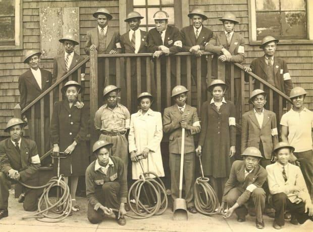This photo of an all-Black fire brigade is on display at The Army Museum, and staff are asking people on social media to help identify the members of the group. (The Army Museum - image credit)