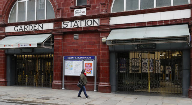 Several underground train tube stations are to be closed and buses reduced due to the COVID-19 virus. (AP Photo/Kirsty Wigglesworth)