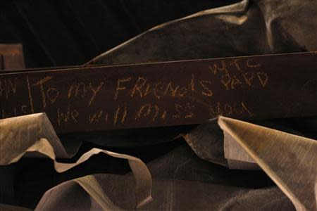 """A message is seen on the bottom of the """"Cross"""", intersecting steel beams found in the rubble of 6 World Trade Center that was destroyed on September 11, 2001, displayed in The National September 11 Memorial and Museum, under construction, at the World Trade Center site in New York in this September 6, 2013 file photo. REUTERS/Brendan McDermid/Files"""