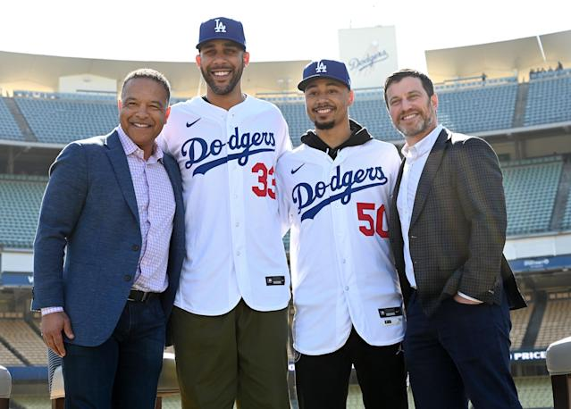 (From left) Manager Dave Roberts, newly acquired Los Angeles Dodgers David Price and Mookie Betts, and team president Andrew Friedman pose Wednesday at Dodger Stadium in Los Angeles. (Photo by Jayne Kamin-Oncea/Getty Images)
