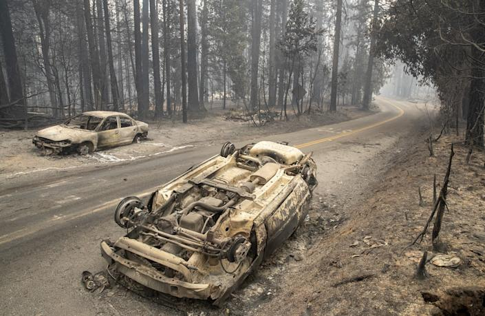 "An overturned car on Bald Rock Rd. in the aftermath of the Bear fire in Brush Creek. <span class=""copyright"">(Brian van der Brug/Los Angeles Times)</span>"