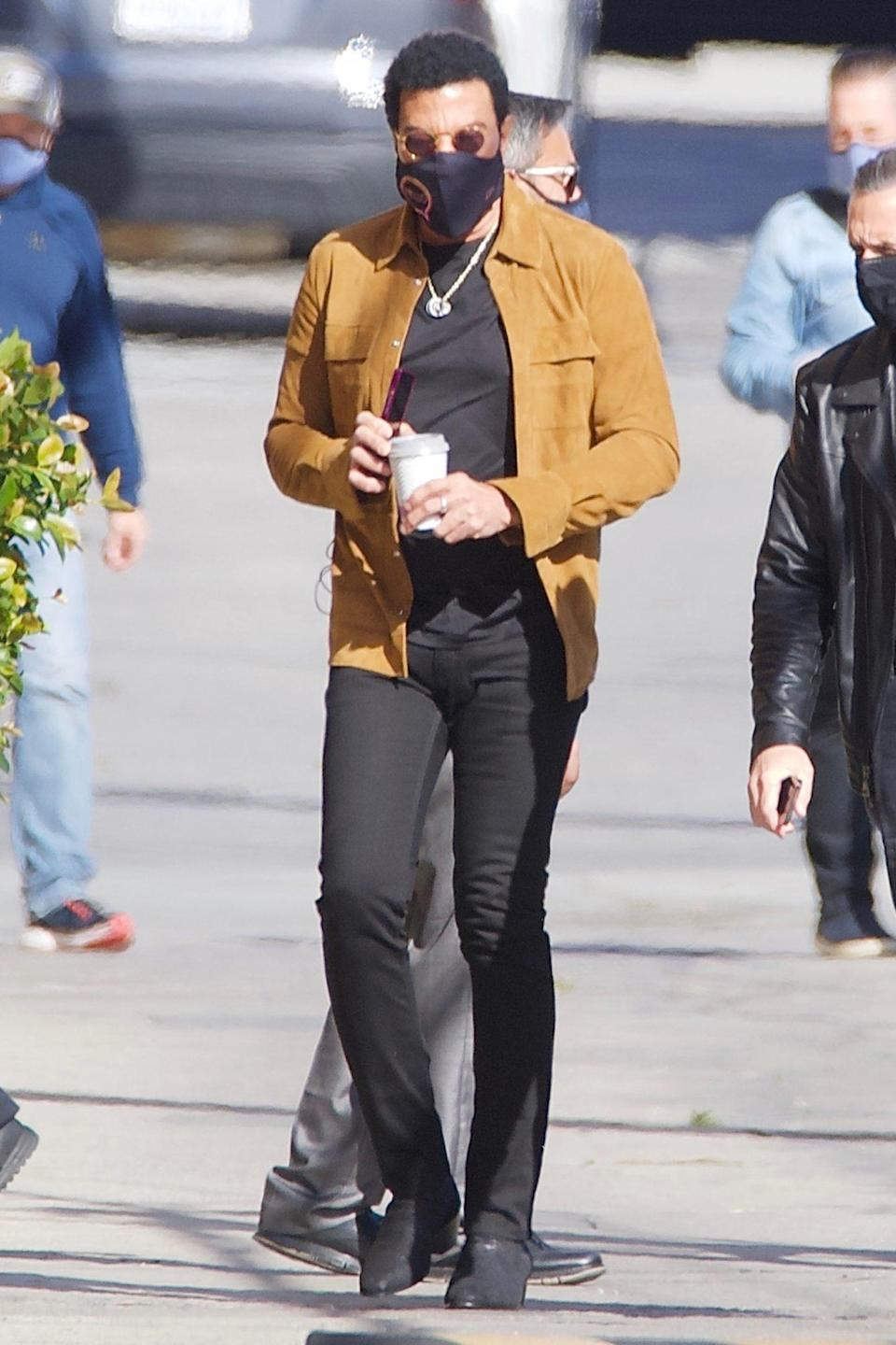 <p>Lionel Richie fuels up with a coffee as he heads to a film studio in Hollywood on Friday. </p>