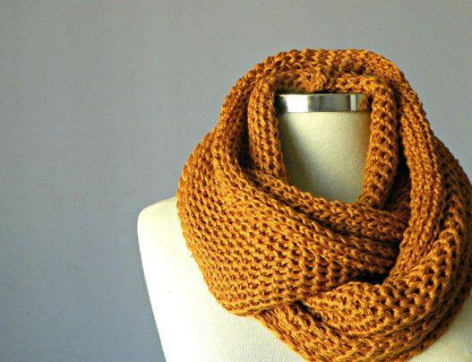"""<a href=""""https://www.etsy.com/ca/listing/173950222/mustard-knitted-infinity-scarf-cowl-hood?ref=br_feed_46&br_feed_tlp=gifts"""" target=""""_blank"""">Mustard Knitted infinity scarf, $11.05, available at Etsy</a>"""