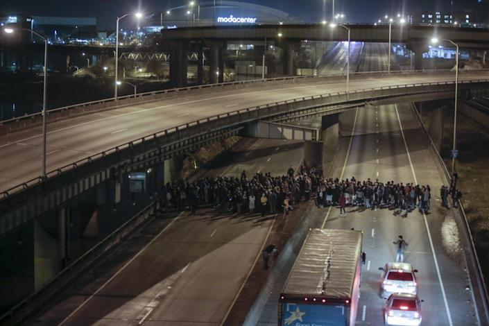 <p>Protesters walk in the middle of traffic lanes after Donald Trump's election victory, Tuesday, Nov. 8, 2016 in downtown, Portland, Ore. Portland police made no arrests during Tuesday night's post-election protest. (Stephanie Yao Long//The Oregonian via AP) </p>