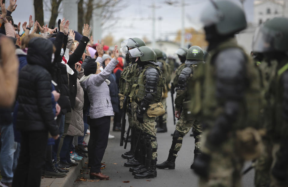 People argue with policemen during an opposition rally to protest the official presidential election results in Minsk, Belarus, Sunday, Nov. 1, 2020. Nearly three months after Belarus' authoritarian president's re-election to a sixth term in a vote widely seen as rigged, the continuing rallies have cast an unprecedented challenge to his 26-year rule. (AP Photo)