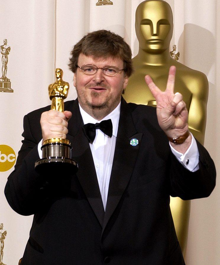 Michael Moore flashes a peace sign in the press room following his Oscar win. (Photo: Mark J. Terrill/AP)<br>