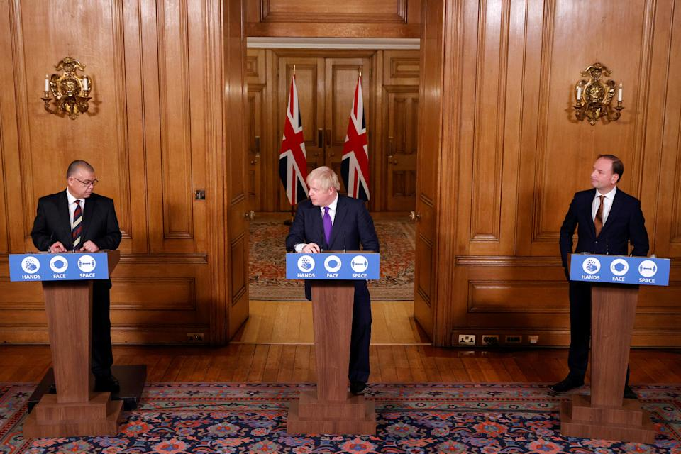 (left to right) Deputy Chief Medical Officer for England Jonathan Van-Tam, Prime Minister Boris Johnson and NHS Chief Executive, Sir Simon Stevens during a media briefing on coronavirus (COVID-19) in Downing Street, London. (Photo by John Sibley/PA Images via Getty Images)