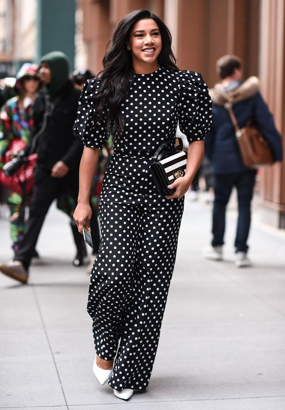 """<p>The puffy sleeve trend has been going strong and will continue well into fall 2020. Think: even <em>bigger</em>, more exaggerated sleeves.</p><p><strong>What you'll need:</strong> <em>High-Neck Puff Sleeve Polka-Dot Jumpsuit</em><em>, $72, ASOS</em></p><p><a class=""""link rapid-noclick-resp"""" href=""""https://go.redirectingat.com?id=74968X1596630&url=https%3A%2F%2Fwww.asos.com%2Fus%2Fasos-design%2Fasos-design-high-neck-ruched-waist-tea-jumpsuit-in-polka-dot%2Fprd%2F14546429&sref=https%3A%2F%2Fwww.seventeen.com%2Ffashion%2Fstyle-advice%2Fg22548712%2Fcute-fall-outfits%2F"""" rel=""""nofollow noopener"""" target=""""_blank"""" data-ylk=""""slk:SHOP HERE"""">SHOP HERE</a></p>"""
