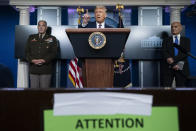 President Donald Trump speaks during a news conference in the James Brady Press Briefing Room of the White House, Friday, Sept. 18, 2020, in Washington, as Army Gen. Gustave Perna, who is leading Operation Warp Speed, and Dr. Moncef Slaoui, chief adviser to Operation Warp Speed, listen. (AP Photo/Alex Brandon)