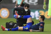 Southampton's Danny Ings is treated after getting injured during an English Premier League soccer match between Sheffield United and Southampton at the Bramall Lane stadium in Sheffield, England, Saturday March 6, 2021. (Mike Egerton/Pool via AP)