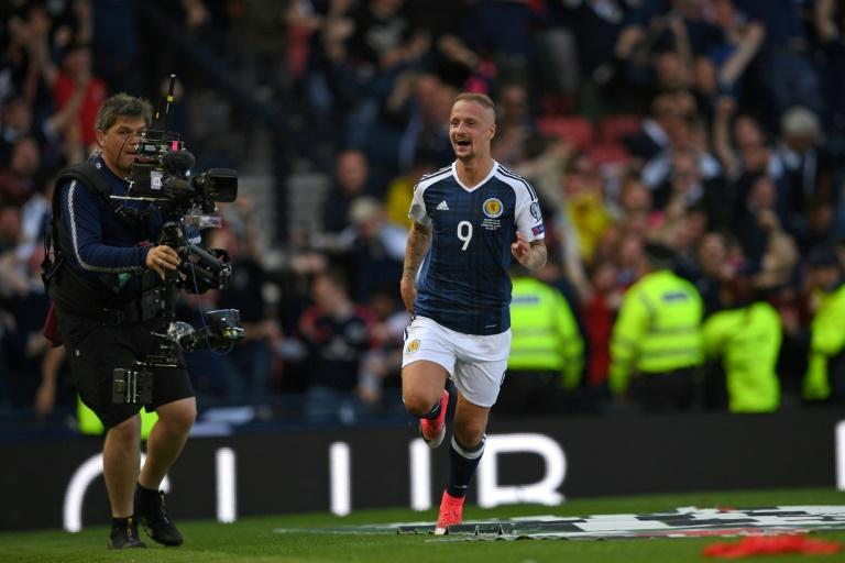 Leigh Griffiths, pictured in June 2017, tied a Celtic scarf to a post at Belfast's Windsor Park and UEFA have upheld their decision to punish the striker