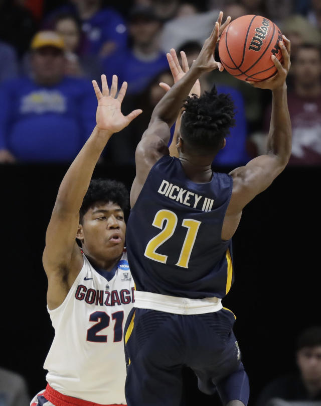Gonzaga forward Rui Hachimura (21) defends as UNC-Greensboro forward James Dickey III puts up a shot during the first half of an NCAA college basketball tournament first-round game, Thursday, March 15, 2018, in Boise, Idaho. (AP Photo/Ted S. Warren)