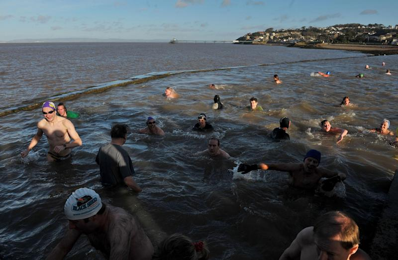 Swimmers dive in for the Annual New Year's Day swim at the Marine Swimming Lake in Clevedon, Somerset. (Photo by Tim Ireland/PA Images via Getty Images)
