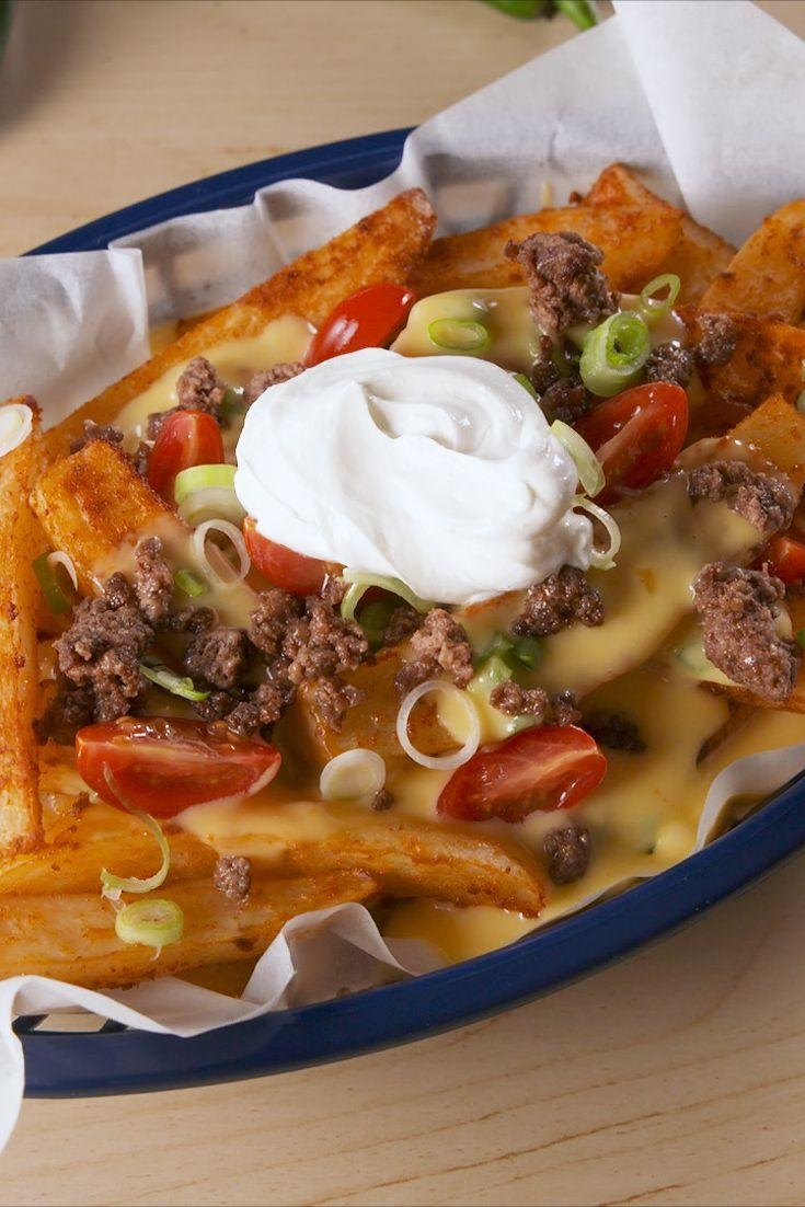 """<p>Fries with nacho toppings? YES PLEASE!</p><p>Get the recipe from <a href=""""https://www.delish.com/cooking/recipe-ideas/a19623497/nacho-fries-bellgrande-recipe/"""" rel=""""nofollow noopener"""" target=""""_blank"""" data-ylk=""""slk:Delish"""" class=""""link rapid-noclick-resp"""">Delish</a>. </p>"""