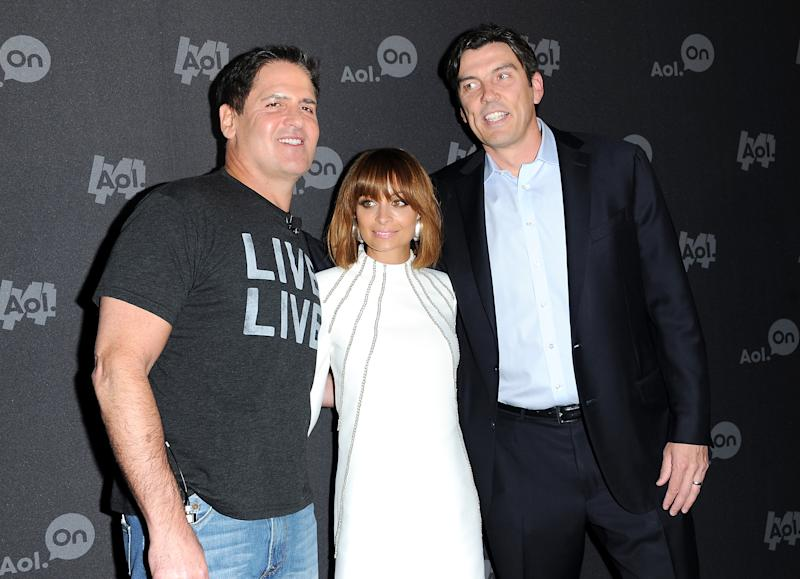 """Entrepreneur Mark Cuban, from left, Nicole Richie and AOL CEO Tim Armstrong attend AOL's web series """"NewFront"""" at Moynihan Station on Tuesday April 30, 2013 in New York. (Photo by Evan Agostini/Invision/AP)"""