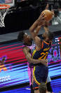 Golden State Warriors forward Andrew Wiggins (22) drives to the basket as Miami Heat forward Jimmy Butler (22) defends during the second half of an NBA basketball game, Thursday, April 1, 2021, in Miami. (AP Photo/Marta Lavandier)