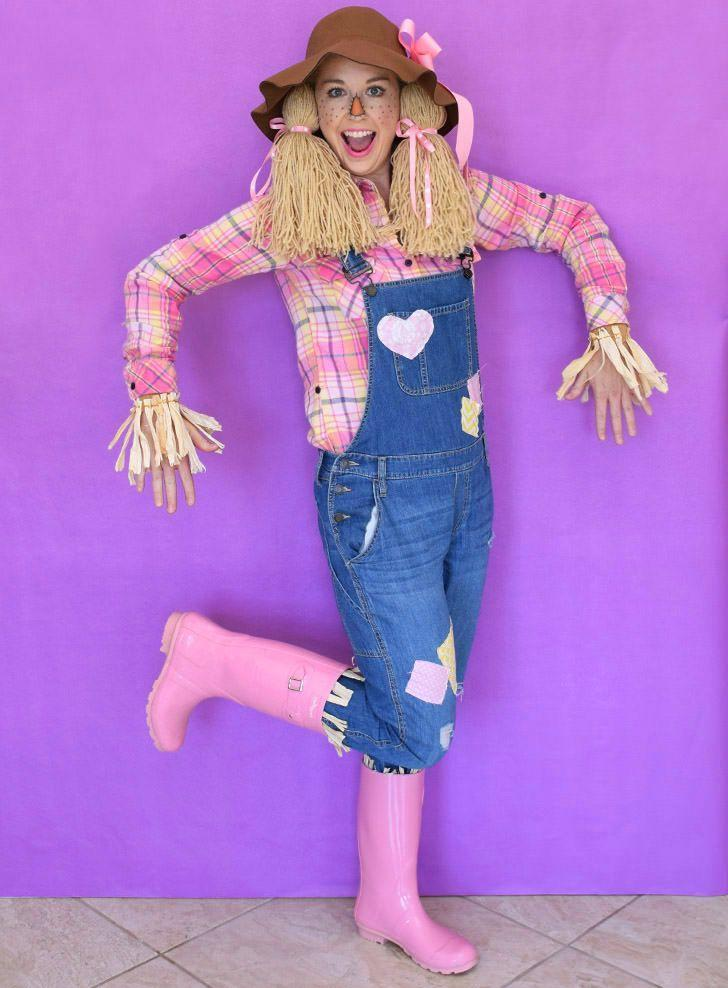 """<p>Think pink! DIY yarn pigtails take this cheerful scarecrow costume to the next level. </p><p><strong>Get the tutorial at <a href=""""https://www.dreamalittlebigger.com/post/super-last-minute-scarecrow-costume.html"""" rel=""""nofollow noopener"""" target=""""_blank"""" data-ylk=""""slk:Dream A Little Bigger"""" class=""""link rapid-noclick-resp"""">Dream A Little Bigger</a>.</strong><br></p><p><a class=""""link rapid-noclick-resp"""" href=""""https://www.amazon.com/Grace-Elbe-Womens-Collared-Flannel/dp/B0772MWD8W/ref=sr_1_3?tag=syn-yahoo-20&ascsubtag=%5Bartid%7C10050.g.28190286%5Bsrc%7Cyahoo-us"""" rel=""""nofollow noopener"""" target=""""_blank"""" data-ylk=""""slk:SHOP PINK PLAID SHIRTS"""">SHOP PINK PLAID SHIRTS</a></p>"""