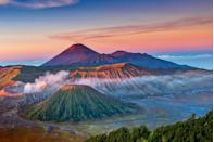 "<p><a href=""https://www.tripadvisor.com/Attraction_Review-g297710-d6515931-Reviews-Bromo_Tengger_Semeru_National_Park-Malang_East_Java_Java.html"" rel=""nofollow noopener"" target=""_blank"" data-ylk=""slk:The Tengger massif"" class=""link rapid-noclick-resp"">The Tengger massif</a> is a large active volcanic complex surrounded by sweeping plains of sand. At sunset, this site is the epitome of desolate beauty. </p>"