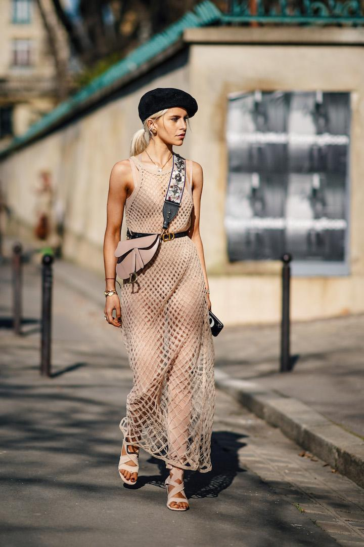 <p>Caroline Daur was the definition of Parisian chic this season, as she took to the streets in a black beret and fishnet dress. Who else is in desperate need of her saddle bag? <em>[Photo: Getty]</em> </p>