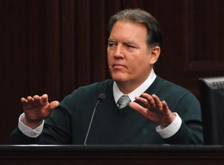 Defendant Michael Dunn gestures on the stand during testimony in his own defense during his murder trial in Duval County Courthouse in Jacksonville, Florida February 11, 2014. REUTERS/Bob Mack/Pool