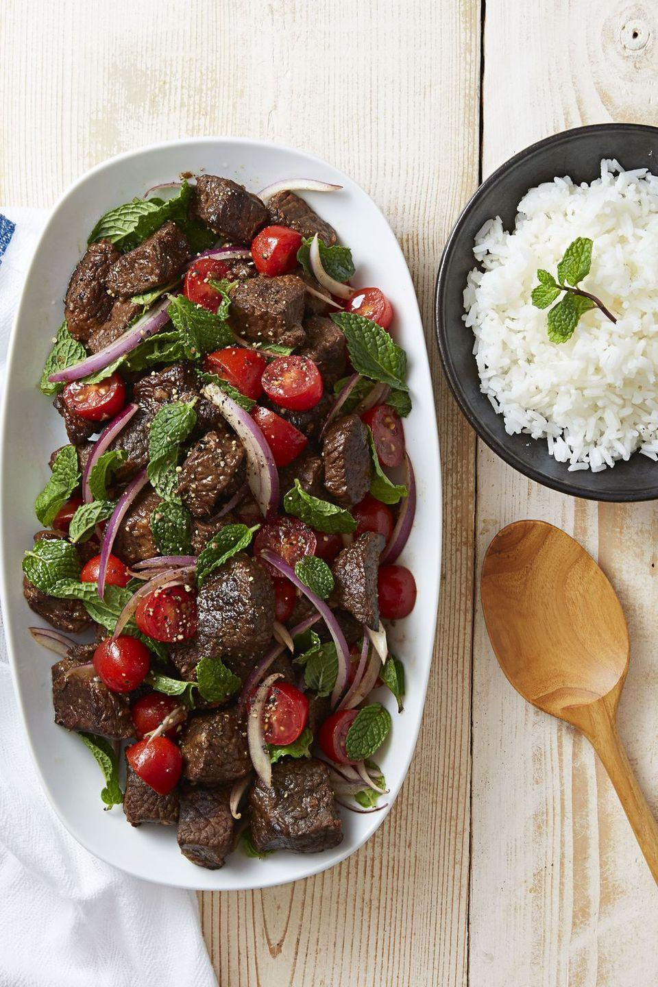 """<p>Trimming the fat off a lean beef brisket makes this flavorful cut so much better for your waistline. Paired with zesty onions and fresh tomatoes, this slow-roasted beef dinner contains a mere 290 calories.<br></p><p><a href=""""https://www.goodhousekeeping.com/food-recipes/a37553/soy-braised-beef-tomato-mint-salad-recipe/"""" rel=""""nofollow noopener"""" target=""""_blank"""" data-ylk=""""slk:Get the recipe for Soy-Braised Beef & Tomato-Mint Salad »"""" class=""""link rapid-noclick-resp""""><em>Get the recipe for Soy-Braised Beef & Tomato-Mint Salad »</em></a></p>"""