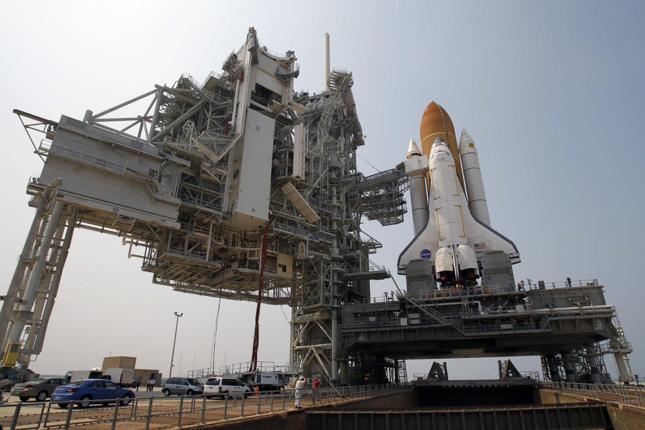 FILE - In this Friday, June 17, 2011 file photo, space shuttle Atlantis is mounted on Pad 39A at the Kennedy Space Center in Cape Canaveral, Fla. Dormant for nearly six years, Launch Complex 39A at NASA's Kennedy Space Center should see its first commercial flight on Feb. 18, 2017. A SpaceX Falcon 9 rocket will use the pad to hoist supplies for the International Space Station. (AP Photo/John Raoux)