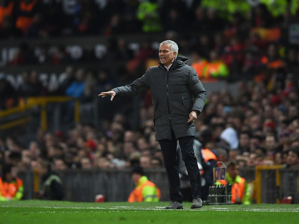 Mourinho barks instructions from the touchline: Getty