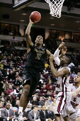 Missouri's Tony Criswell (3) drives for the basket as South Carolina's Brenton Williams (1) defends during the first half of their NCAA college basketball game, Thursday, Feb. 28, 2013, in Columbia, S.C. (AP Photo/Mary Ann Chastain)