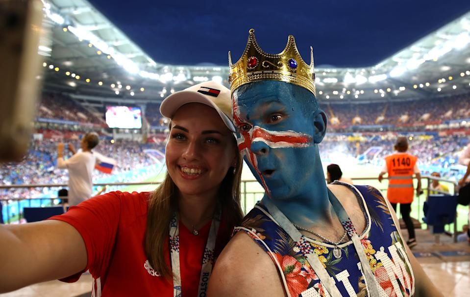 <p>Fans enjoy the pre match atmosphere prior to the 2018 FIFA World Cup Russia group D match between Iceland and Croatia at Rostov Arena on June 26, 2018 in Rostov-on-Don, Russia. (Photo by Maja Hitij – FIFA/FIFA via Getty Images) </p>