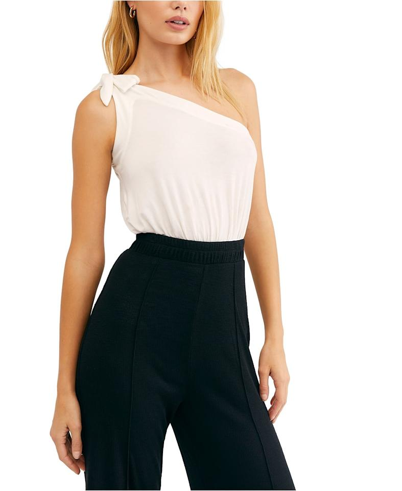"""<p>This sexy <a href=""""https://www.popsugar.com/buy/Free-People-Shindig-Bold-Shoulder-Top-499365?p_name=Free%20People%20Shindig%20Bold%20Shoulder%20Top&retailer=macys.com&pid=499365&price=48&evar1=fab%3Aus&evar9=46631817&evar98=https%3A%2F%2Fwww.popsugar.com%2Fphoto-gallery%2F46631817%2Fimage%2F46732585%2FFree-People-Shindig-Bold-Shoulder-Top&list1=shopping%2Cfall%20fashion%2Cfall%2Ctops%2Cmacys&prop13=api&pdata=1"""" rel=""""nofollow"""" data-shoppable-link=""""1"""" target=""""_blank"""" class=""""ga-track"""" data-ga-category=""""Related"""" data-ga-label=""""https://www.macys.com/shop/product/free-people-shindig-bold-shoulder-top?ID=9367813&amp;CategoryID=255"""" data-ga-action=""""In-Line Links"""">Free People Shindig Bold Shoulder Top</a> ($48) comes in several shades.</p>"""