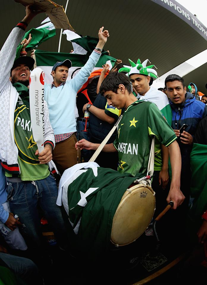 BIRMINGHAM, ENGLAND - JUNE 15:  A young Pakistan cricket fan plays a drum, during the rain interval during the ICC Champions Trophy Group A match between India and Pakistan at Edgbaston on June 15, 2013 in Birmingham, England.  (Photo by Matthew Lewis-ICC/ICC via Getty Images)