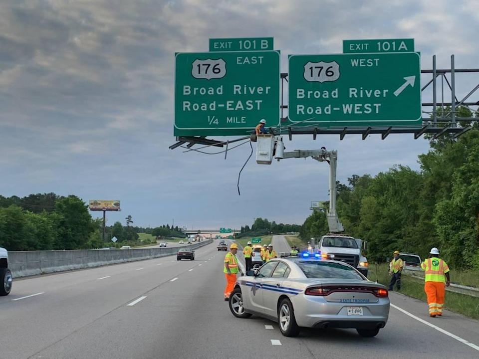Crews work to repair a sign that was hit by a truck, according to South Carolina Highway Patrol.