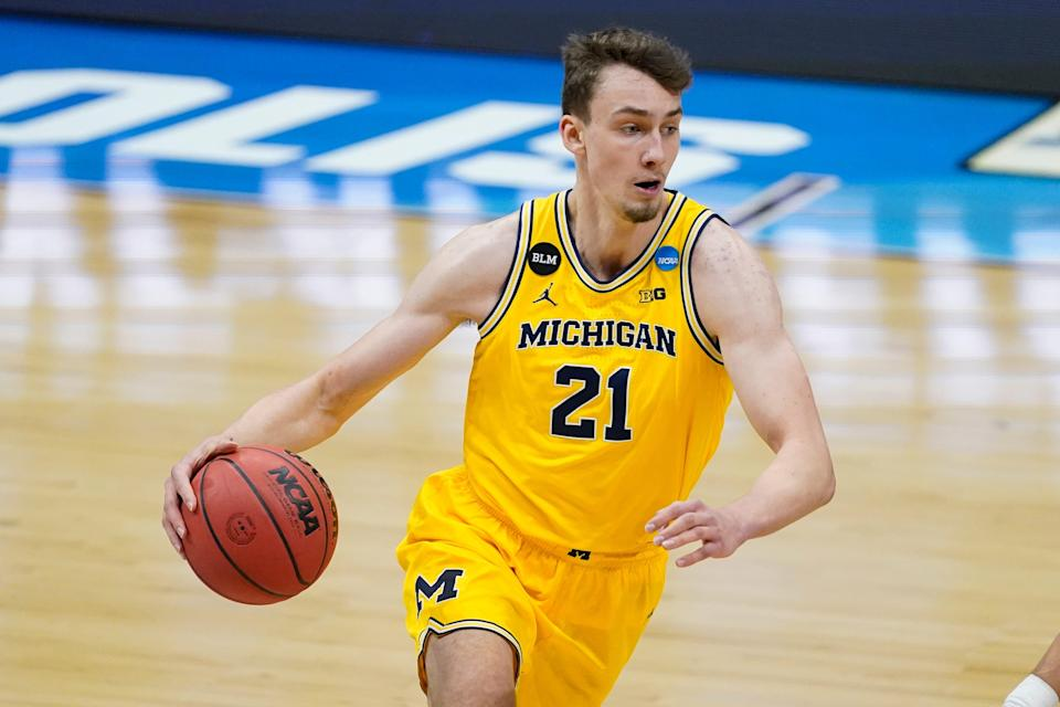 Michigan guard Franz Wagner drives up court during the first half of an Elite Eight game in the NCAA tournament on Tuesday, March 30, 2021, in Indianapolis.