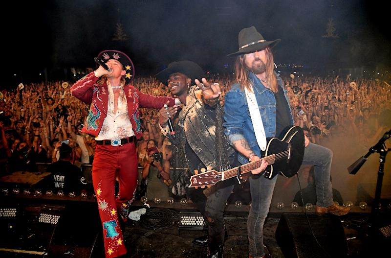 (L-R) DJ Diplo, Lil Nas X, and Billy Ray Cyrus perform onstage during the 2019 Stagecoach Festival in California (AFP Photo/Frazer Harrison)