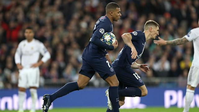 Paris Saint-Germain served up late drama at Real Madrid to secure a draw and top spot in Group A in the Champions League.