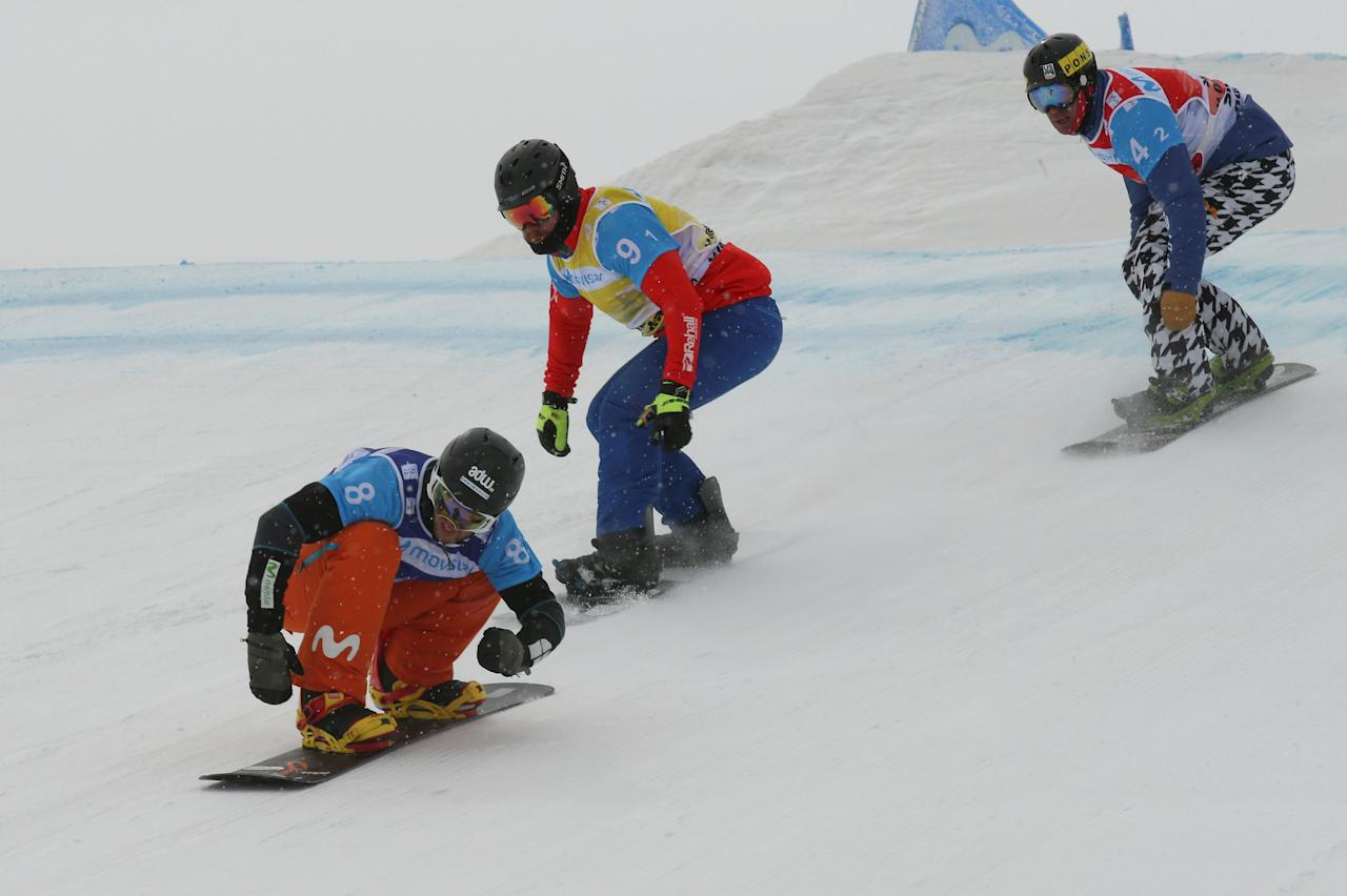REFILE - CORRECTING IDENTITY OF TWO COMPETITORS  Snowboarding - FIS Snowboarding and Freestyle Skiing World Championships - Men's Team Snowboard Cross - Sierra Nevada, Spain - 13/03/17   (L to R) Lucas Eguibar of Spain, Lukas Pachner of Austria and Nick Baumgartner of the US in action during the semi final.  REUTERS/Albert Gea