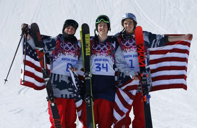U.S. finalists second placed Gus Kenworthy, winner Joss Christensen and third placed Nicholas Goepper (L-R) celebrate on podium after the men's freestyle skiing slopestyle finals at the 2014 Sochi Winter Olympic Games in Rosa Khutor, February 13, 2014. REUTERS/Mike Blake (RUSSIA - Tags: SPORT OLYMPICS SPORT SKIING)