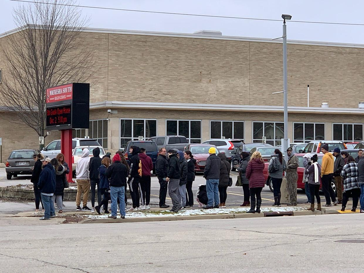 Parents gather outside Waukesha South High School moments before the school began releasing students at 11:15 a.m. Monday.