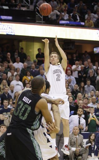 Akron's Brian Walsh (2) takes the final shot late in the second half during an NCAA college basketball championship game against Ohio in the Mid-American Conference men's tournament on Saturday, March 10, 2012, in Cleveland. Ohio won 64-63. (AP Photo/Tony Dejak)