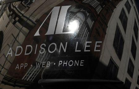 An Addison Lee minicab drives through central London