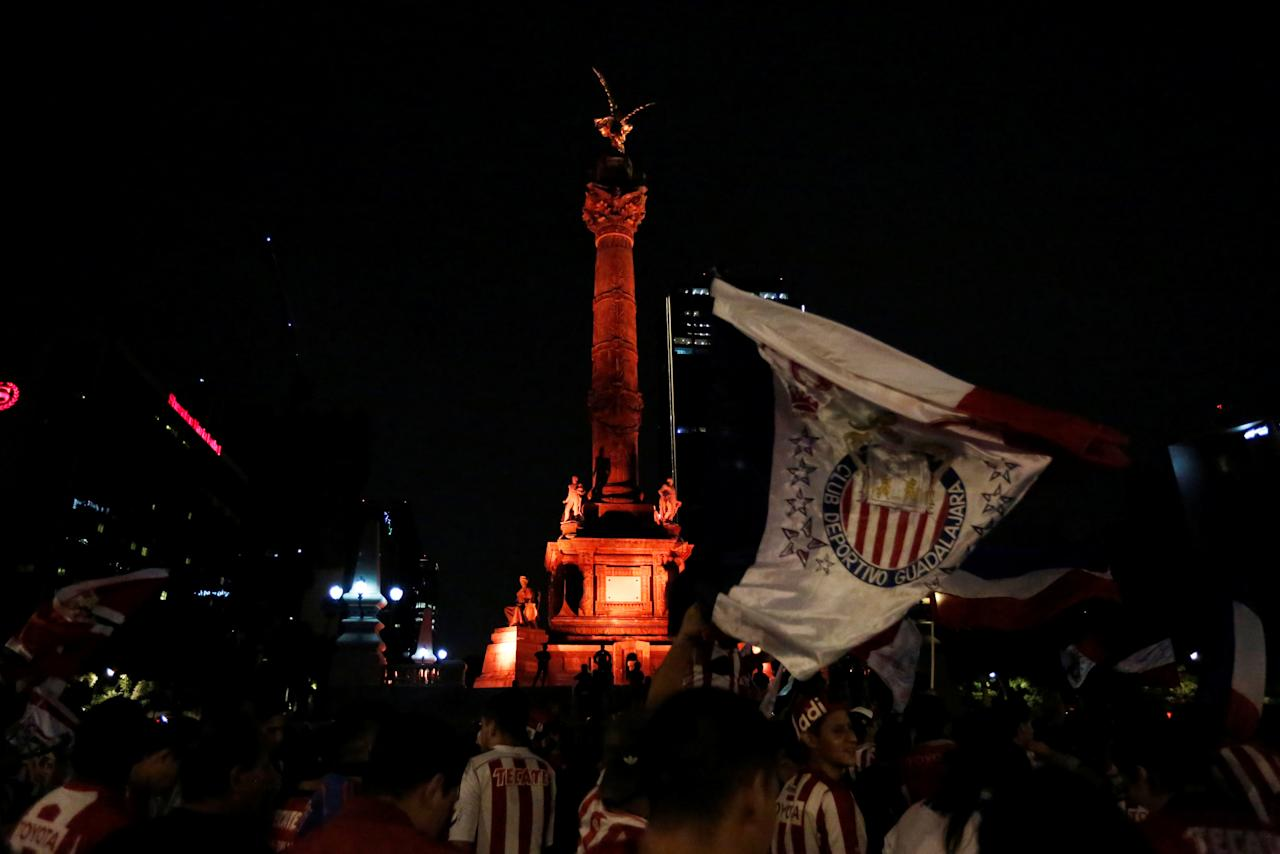 Fans of Chivas de Guadalajara celebrate at the Angel de la Independencia monument after winning the Mexican First Division Final, in Mexico City, Mexico May 28, 2017. REUTERS/Carlos Jasso