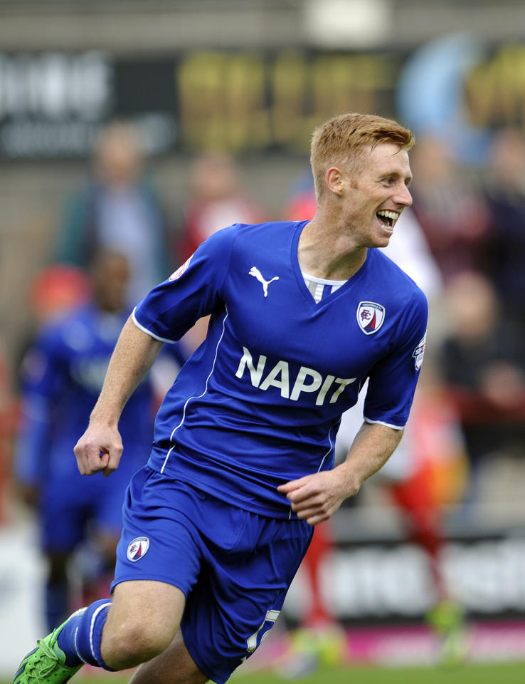 Chesterfield's Eoin Doyle celebrates after he scores the first goal of the game for his side during the Sky Bet League Two match at Globe Arena, Morecambe.