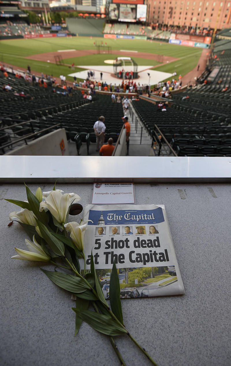 Orioles pay tribute to 5 shooting victims at capital gazette a memorial for capital gazette sports writer john mcnamara is displayed at a seat in the malvernweather Images