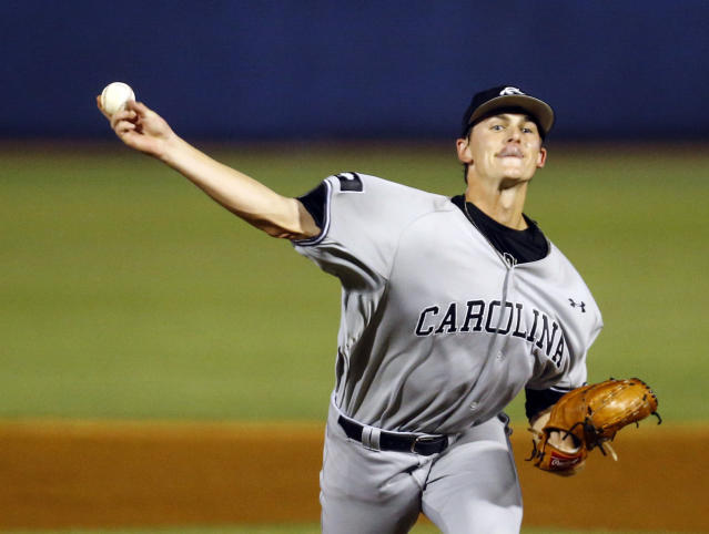 South Carolina's Cam Tringali throws a pitch to an LSU batter during the first inning of the Southeastern Conference tournament NCAA college baseball game Tuesday, May 21, 2019, in Birmingham, Ala. (AP Photo/Butch Dill)