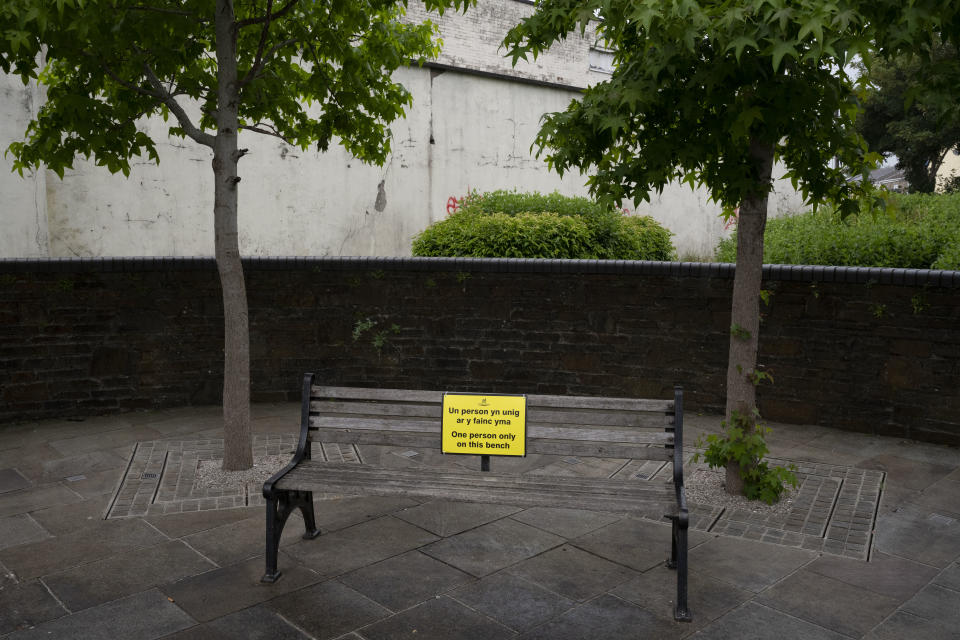 """ABERDARE, UNITED KINGDOM - JUNE 10: A bench with a sign saying """"one person only on this bench"""" as part of Rhondda Cynon Taf's social distancing and COVID-19 reduction measures on June 10, 2020 in Aberdare, United Kingdom. The Welsh government has further relaxed COVID-19 lockdown measures this week, allowing people from different households to meet up outside while maintaining social distancing. Schools have remained closed and those who have been advised to shield at home can go outside again but have been told to avoid shopping. (Photo by Matthew Horwood/Getty Images)"""