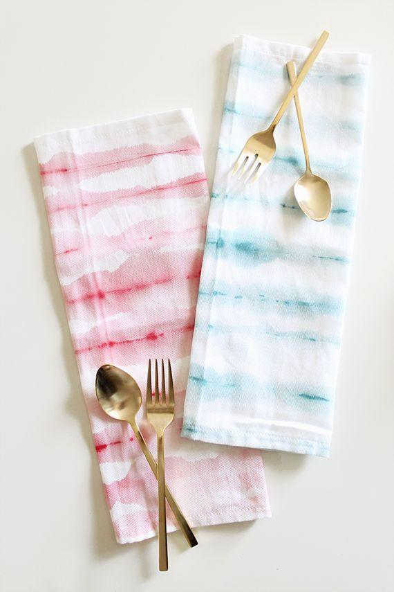 """<p>With fabric paint, white napkins, a brush, and water, you can quickly add elegance to your table decor while honoring the holiday. </p><p><em>Get the tutorial from <a href=""""http://almostmakesperfect.com/2014/06/26/diy-watercolor-stripe-napkins/"""" rel=""""nofollow noopener"""" target=""""_blank"""" data-ylk=""""slk:Almost Makes Perfect"""" class=""""link rapid-noclick-resp"""">Almost Makes Perfect</a>.</em></p><p><strong><strong>What You'll Need:</strong></strong> <a href=""""https://www.amazon.com/Tulip-One-Step-Color-Tie-Dye-Ultimate/dp/B00D32MDN4/ref=sr_1_1_sspa?dchild=1&keywords=tie+dye+kit&qid=1593181614&s=arts-crafts&sr=1-1-spons&psc=1&spLa=ZW5jcnlwdGVkUXVhbGlmaWVyPUFBSlc4OEVDVkpIUkkmZW5jcnlwdGVkSWQ9QTA1OTI1ODQ5MFpLQ1lQOFlHTTImZW5jcnlwdGVkQWRJZD1BMDI1MTM0MDI5M0ZMMU85QlhZRzQmd2lkZ2V0TmFtZT1zcF9hdGYmYWN0aW9uPWNsaWNrUmVkaXJlY3QmZG9Ob3RMb2dDbGljaz10cnVl&tag=syn-yahoo-20&ascsubtag=%5Bartid%7C10070.g.2446%5Bsrc%7Cyahoo-us"""" rel=""""nofollow noopener"""" target=""""_blank"""" data-ylk=""""slk:Fabric paint"""" class=""""link rapid-noclick-resp"""">Fabric paint </a>($20, Amazon)</p>"""