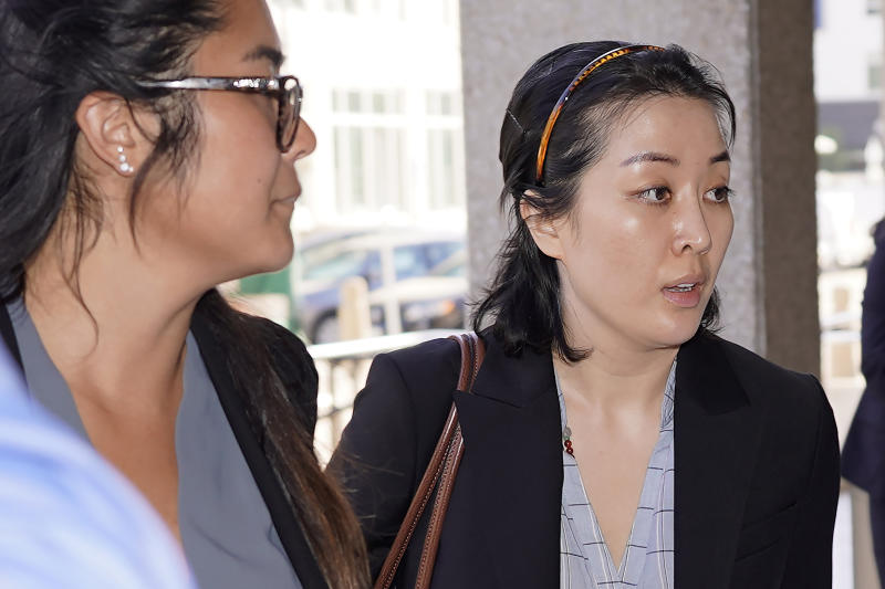 Tiffany Li, right, arrives at the courthouse Thursday, Sept. 12, 2019, in Redwood City, Calif. The trial of Li, a Chinese real estate scion who posted a $35 million bail after being charged with orchestrating the 2016 murder of her children's father, is set to start Thursday.(AP Photo/Tony Avelar)